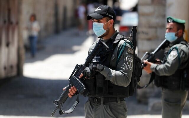 Border Police officers patrol in the area of Jerusalem's Old City where police shot dead an East Jerusalem man with special needs who they though was carrying a gun, May 30, 2020. (Ahmad Gharabli/AFP)