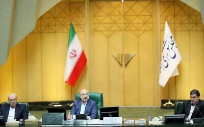 This handout picture provided by the Islamic Consultative Assembly News Agency (ICANA) on May 31, 2020, shows Iranian Parliament speaker Mohammad Bagher Ghalibaf (C) chairing a parliament session in the capital Tehran (ICANA NEWS AGENCY / AFP)