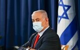 Prime Minister Benjamin Netanyahu, wearing a protective face mask, chairs the weekly cabinet meeting in Jerusalem on May 31, 2020. (Ronen Zvulun/ Pool/ AFP)