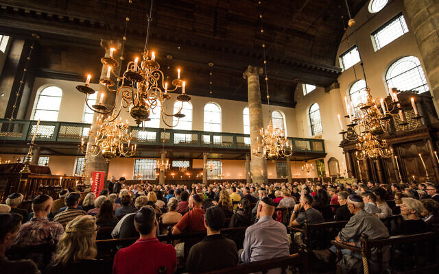 Concertgoers attend a performance at the Portuguese Synagogue in Amsterdam, August 17, 2017. (Cnaan Liphshiz/ JTA)