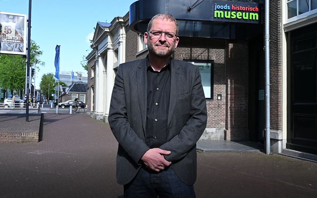 Emile Schrijver, director of the Jewish Cultural Quarter, stands in the area located in the center of Amsterdam, May 4, 2020. (Cnaan Liphshiz/JTA)