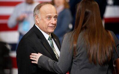 US Rep. Steve King of Iowa speaks to an audience member ahead of a campaign rally at Drake University in Des Moines, January 30, 2020. (Tom Brenner/Getty Images/via JTA)