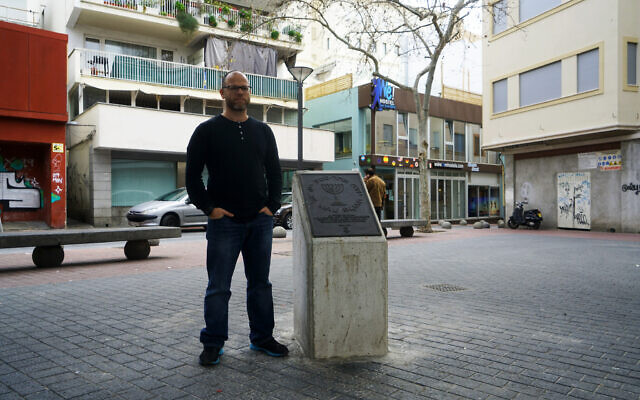 Dani Rotstein stands next to a monument commemorating the Jews of Palma de Mallorca, Spain, February 13, 2019. (Cnaan Liphshiz/ JTA)