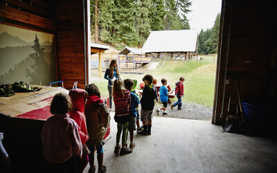 A counselor lines up campers to go outside. (Getty Images)