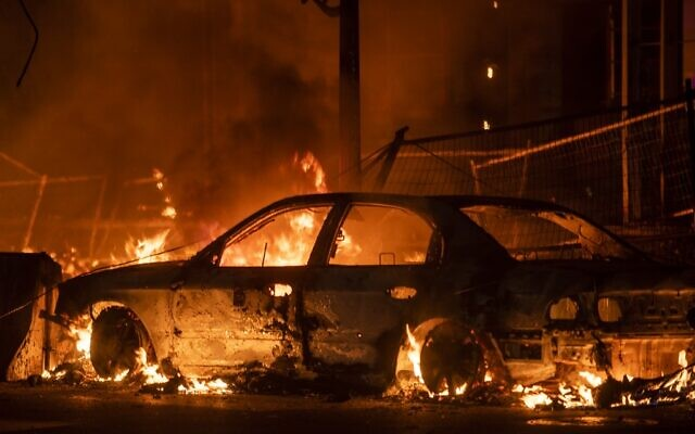 A car burns near the Third Police Precinct on May 27, 2020 in Minneapolis, Minnesota, during riots speaked by the police killing of George Floyd. (Stephen Maturen/Getty Images/AFP)
