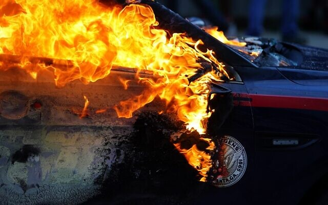 A burning police car is seen during a protest over the Minneapolis death of George Floyd while in police custody on May 29, 2020 in Atlanta, Georgia (Elijah Nouvelage/Getty Images/AFP)