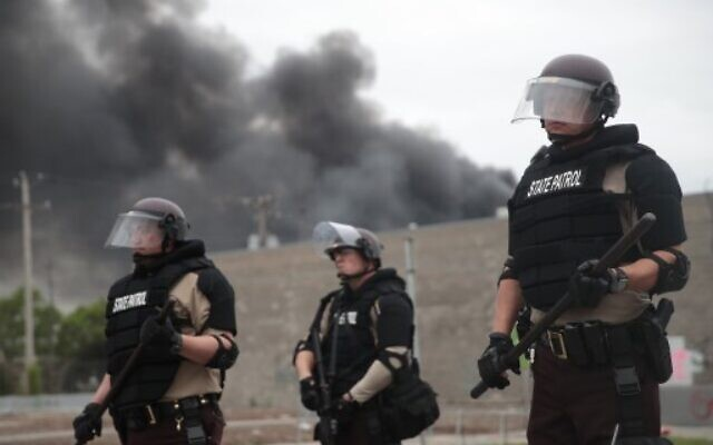 Police hold a line on the fourth day of protests on May 29, 2020 in Minneapolis, Minnesota. The National Guard has been activated as protests continue after the death of George Floyd which has caused widespread destruction and fires across Minneapolis and St. Paul.  (Scott Olson/Getty Images/AFP)