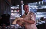Award winning Chef Michael Solomonov, left, works the oven and the line at his restaurant Zahav in Philadelphia, Pennsylvania, on July 14, 2015. (Melina Mara/The Washington Post via JTA)