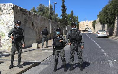 Police near the scene where an East Jerusalem man was shot dead by police in Jerusalem on May 30, 2020 (Yonatan Sindel/Flash90)