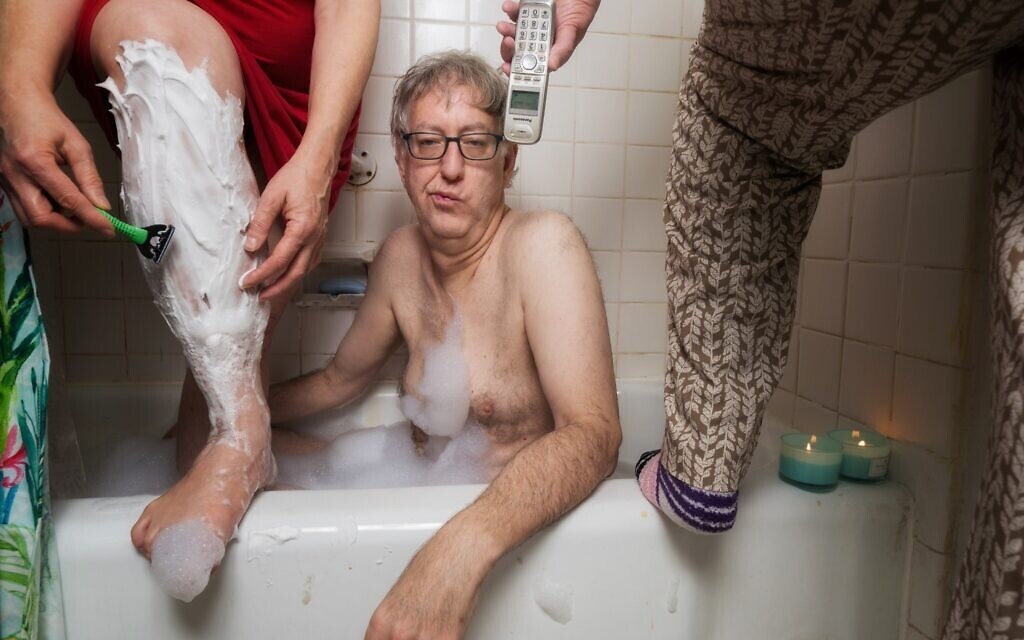 Author and photographer Neil Kramer in a quarantine-style bath with mother and ex wife crowding in. (Courtesy of Kramer)