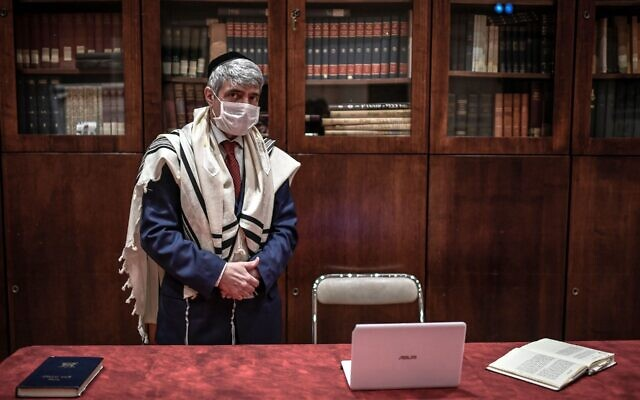 French Rabbi Philippe Haddad prepares for a Shabbat service via videoconference at the Copernic Synagogue in Paris, March 28, 2020. (STEPHANE DE SAKUTIN / AFP)