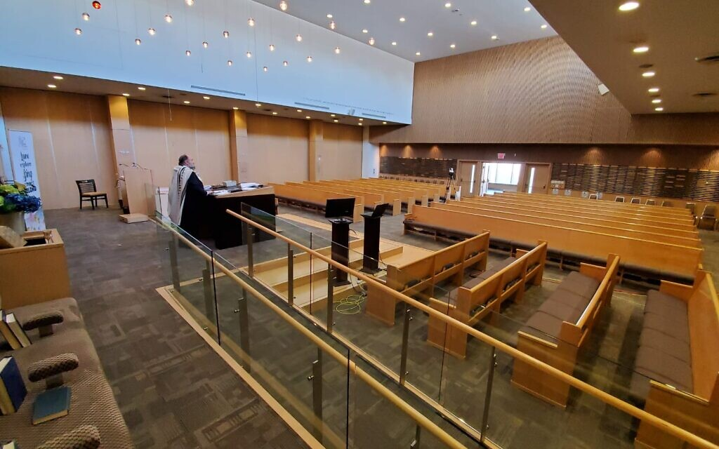 Illustrative: Rabbi Yossi Sapirman holds a prayer service on camera in the city's Beth Torah synagogue, without congregants. (Courtesy of Sapirman/ via JTA)