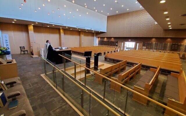 Illustrative: Rabbi Yossi Sapirman holds a prayer service on camera in the city's Beth Torah synagogue, without congregants. (Courtesy of Sapirman/ via JTA)