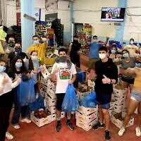 Year Course students this spring wear masks while volunteering. (Courtesy of Year Course/ via JTA)