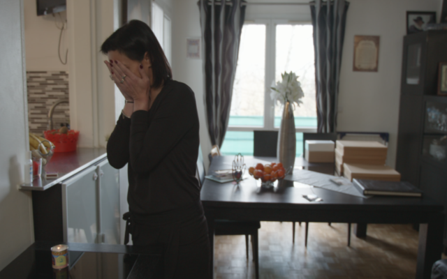"Valerie Braham, widow of one of the victims of the Hyper Cacher grocery store shooting in Paris, appears in ""Viral: Antisemitism in Four Mutations."" (PBS via JTA)"