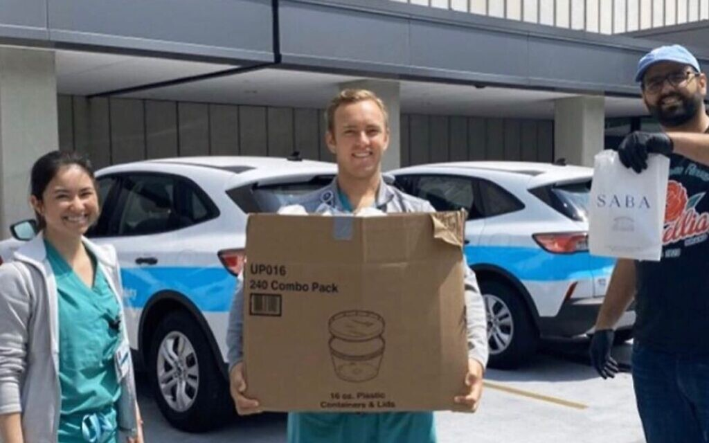 Alon Shaya delivering hummus and pita to medical professionals as part of the @noladocproject. (Saba/ Facebook)