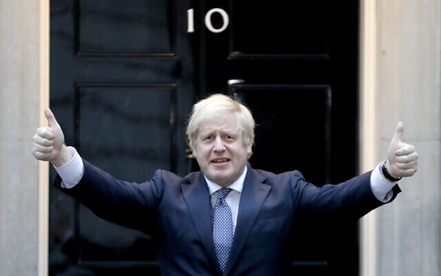 Britain's Prime Minister Boris Johnson shows thumbs up before he applauds on the doorstep of 10 Downing Street in London during the weekly 'Clap for our Carers,' April 30, 2020. (Kirsty Wigglesworth/AP)