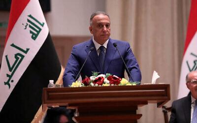 Mustafa al-Kahdimi, Iraqi Prime Minister-designate, speaks to members of the Iraqi parliament in Baghdad, Iraq, May 7, 2020. (Iraqi Parliament Media Office, via AP)