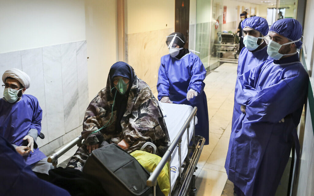 In this March 7, 2020, file photo, a patient infected with the coronavirus is moved, at Baqiyatallah Al'Azam Hospital that is affiliated with the Revolutionary Guard, in Tehran, Iran. (Mohammad Hasan Zarifmanesh/Tasnim News Agency via AP, File)