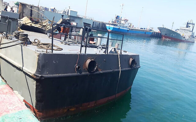 In this photo provided Monday, May 11, 2020, by the Iranian Army, the Konarak support vessel which was struck during a training exercise in the Gulf of Oman, is docked in an unidentified naval base in Iran. (Iranian Army via AP)