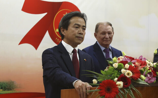Then-Chinese ambassador to Ukraine Du Wei, left, speaks at a ceremonial reception to mark the upcoming 70th anniversary of the founding of the People's Republic of China (PRC) in Kiev, Ukraine, on September 24, 2019  (Sergey Starostenko/Xinhua via AP)