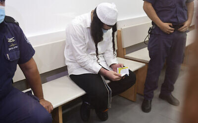 Amiram Ben-Uliel sits in the Lod District Court on May 18, 2020. (Avshalom Sassoni/Pool Photo via AP)