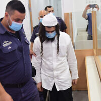 Amiram Ben Uliel in the Lod District Court on May 18, 2020. (Avshalom Sassoni/Pool Photo via AP)