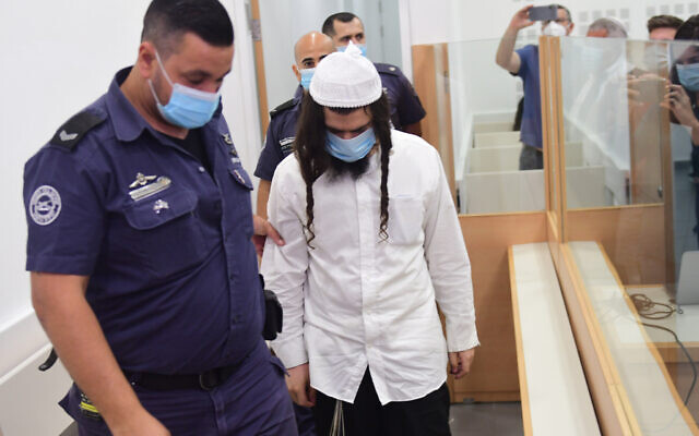 Amiram Ben-Uliel in the Lod District Court on May 18, 2020. (Avshalom Sassoni/Pool Photo via AP)