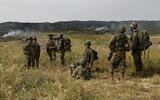 Illustrative: Israeli troops take part in a drill in northern Israel, May 13, 2020. (Tsafrir Abayov/AP)