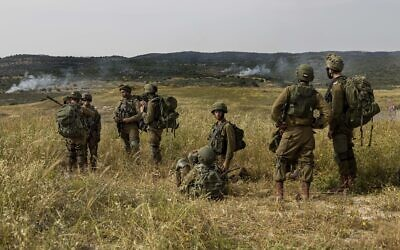 Illustrative: Israeli troops take part in a drill in northern Israel, May 13, 2020. (Tsafrir Abayov/AP)