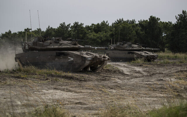 Israeli tanks participating in a military conduct a drills in northern Israel, May 13, 2020. (Tsafrir Abayov/AP)