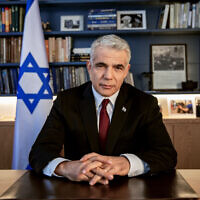 Opposition leader Yair Lapid poses for a photo at his office in Tel Aviv, Israel, May 21, 2020. (AP Photo/Oded Balilty)