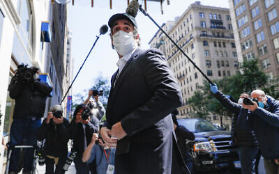 Michael Cohen arrives at his Manhattan apartment in New York after being released federal prison, May 21, 2020. (AP Photo/John Minchillo)