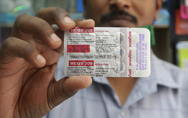 In this on May 19, 2020 file photo, a chemist holds a pack of hydroxychloroquine tablets in Mumbai, India. (AP/Rafiq Maqbool)