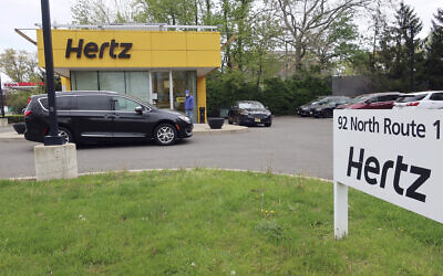 A Hertz car rental is closed during the coronavirus pandemic in Paramus, New Jersey, on May 6, 2020. (AP Photo/Ted Shaffrey, File)