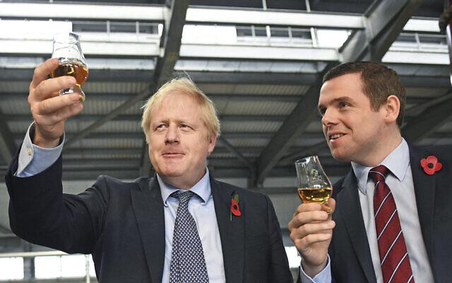 Britain's Prime Minister Boris Johnson (L)with  Douglas Ross, parliamentary under-secretary of state for Scotland, in Moray, Scotland, November 7, 2019.  (Stefan Rousseau / PA via AP)