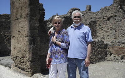 Colleen and Marvin Hewson, from the United States, pose for a photograph during their visit to the archeological sites of Pompeii, near Naples, southern Italy, May 26, 2020. (AP Photo/Alessandra Tarantino)