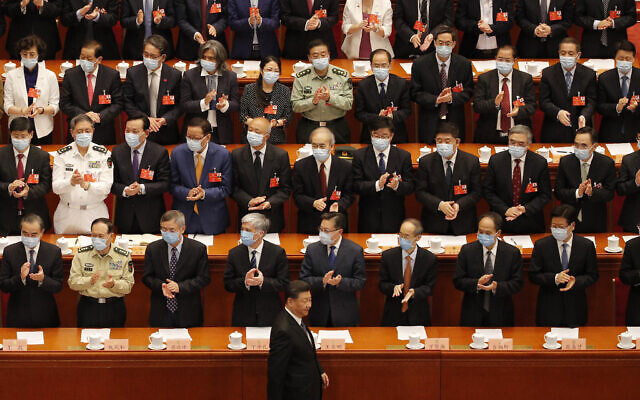 Chinese President Xi Jinping, bottom, arrives for the closing session of the Chinese People's Political Consultative Conference (CPPCC) at the Great Hall of the People in Beijing on May 27, 2020. (AP Photo/Andy Wong)