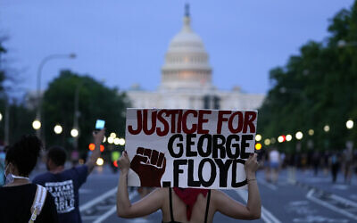 Demonstrators walk along Pennsylvania Avenue as they protest the death of George Floyd, a black man who died in police custody in Minneapolis, Friday, May 29, 2020, in Washington. (AP/Evan Vucci)
