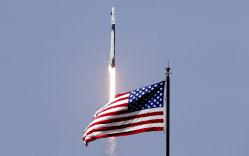 SpaceX blasts off on historic crewed launch, returning US to manned spaceflight
