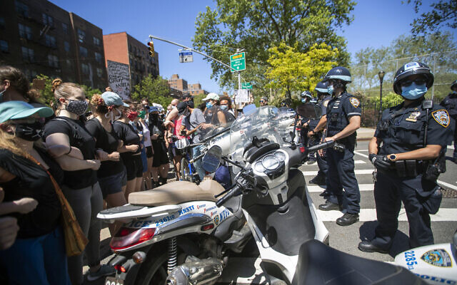 Protesters confront police blocking there access to the FDR Drive during a solidarity rally for George Floyd, Saturday, May 30, 2020, in New York (AP Photo/Mary Altaffer)