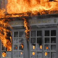 A Los Angeles Police Department kiosk is seen ablaze in The Grove shopping center during a US protest over the death of George Floyd, May 30, 2020, in Los Angeles. (AP Photo/Mark J. Terrill)