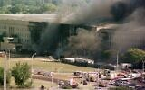 In this Sept. 11, 2001 file photo, the south side of the Pentagon burns (AP Photo/Tom Horan, File)