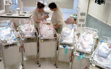 Illustrative. Parents with newborn sextuplets, in the neonatal unit, at St. Johns Mercy Medical Center in Creve Coeur, Missouri, May 21, 2004. (Kyle Ericson/AP/File)