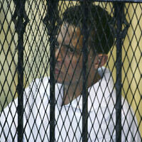 Mohsen el-Sukkary at his trial session at the Cairo's southern court in Cairo, Egypt Saturday, Oct. 18, 2008. (AP/Nasser Nasser)