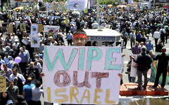 An Iranian protester holds an anti-Israeli placard during an annual anti-Israeli Al-Quds Day rally in Tehran, Iran, June 8, 2018. (AP Photo/Ebrahim Noroozi)