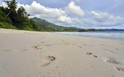 Footprints in the sand, taken on a beach on Mahe island, Seychelles, March 1, 2019. (AP Photo/David Keyton)