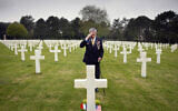 World War II and D-Day veteran Charles Norman Shay, from Indian Island, Maine, salutes the grave of fellow soldier Edward Morozewicz at the Normandy American Cemetery in Colleville-sur-Mer, Normandy, France, May 1, 2019.  (AP Photo/Virginia Mayo)