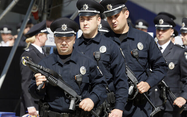 Illustrative: Ukrainian police officers attend a ceremony to launch a new-style police project in Kiev. Ukraine, Tuesday, May 28, 2019. The project goal is to turn the old law enforcement system into the new one which would comply with the European standards. (AP Photo/Efrem Lukatsky)