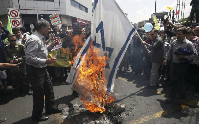 Iranian demonstrators burn a representation of the Israeli flag during their annual protest to mark Quds, or Jerusalem Day, in Tehran, Iran, May 31, 2019 (AP Photo/Vahid Salemi)